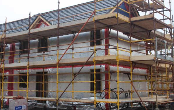 Timber frame home under construction.