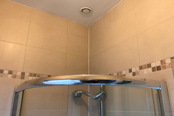 This is a similar shower with the humidity sensing extractor fan but without the extended top section.